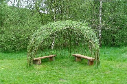 Willow dome. A living structure that shades in the summer and lets heat through in the winter. Plant your own! It's easy, place a willow branchs in water and let them sprout. Place in ground in a circle slightly bigger then you want your dome to be. Let them grow; remember willows love water. Once they are big enough weave their ends.