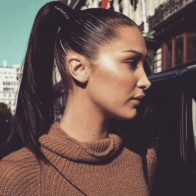 honestly bella hadid is the only model that can pull off this sleeked back high pontail because her cheekbones and contour do it justice