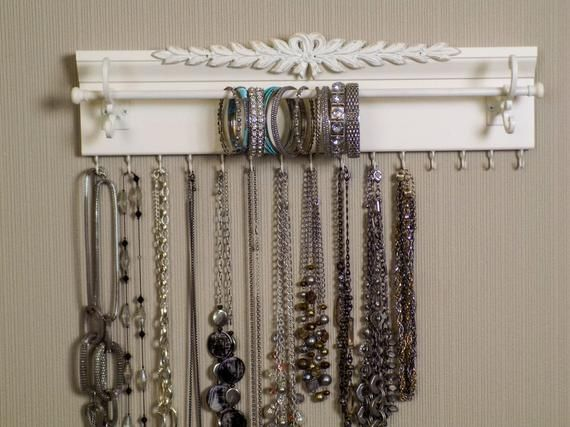 Bracelet and Necklace Jewelry Organizer has 15 Hooks for necklaces. Use as Closet organization & Jewelry storage.Makes a gift w/ wide appeal