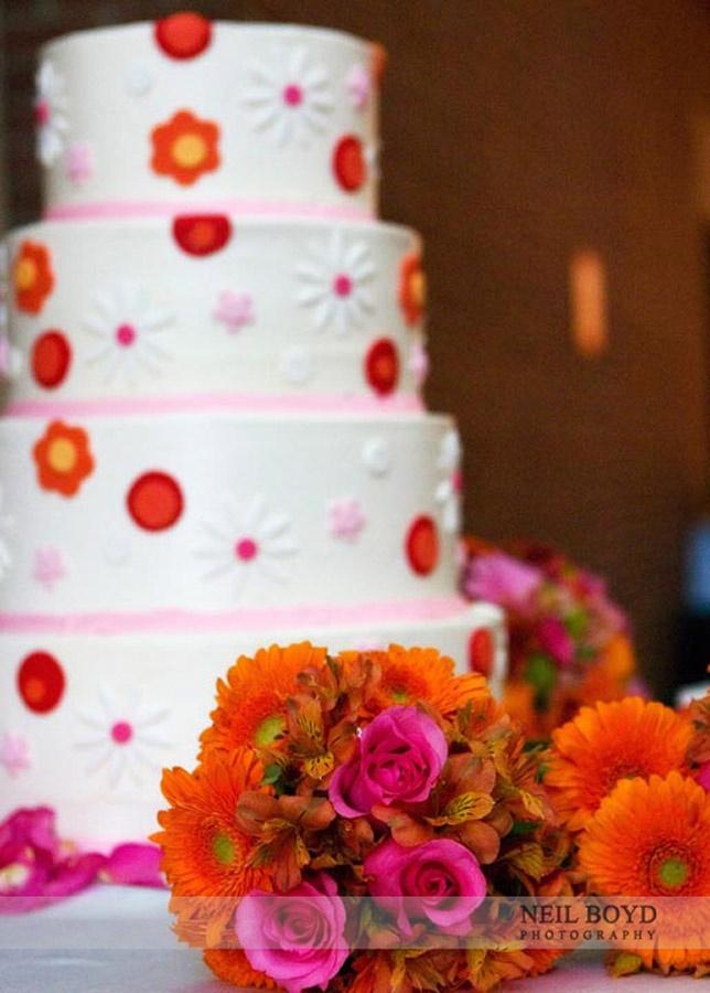 White Icing With Pink Orange Detail Wedding Cake