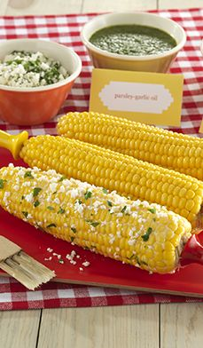 Spice up your next summer party with a savory Corn on the Cob bar. Get recipes for three different spreads—miso-butter, parsley-garlic, and parmesan-lime and printable menu cards! #party #summer #bbq