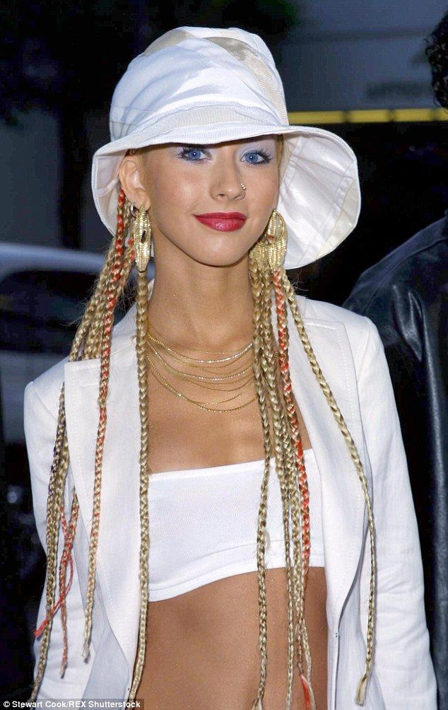 THEN: The bucket hat was originally a staple of fishermen and farmers, but seeped into popular culture, and was sported by the likes of singer Christina Aguilera, now 36, in 2001
