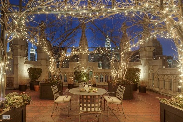 NYC apartment lighted rooftop space with Chrysler building in the background