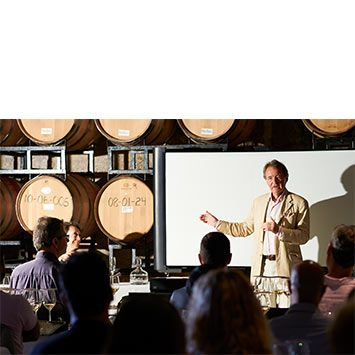Steven Spurrier lecturing in the barrel cellar at Henry of Pelham Family Estate Winery.