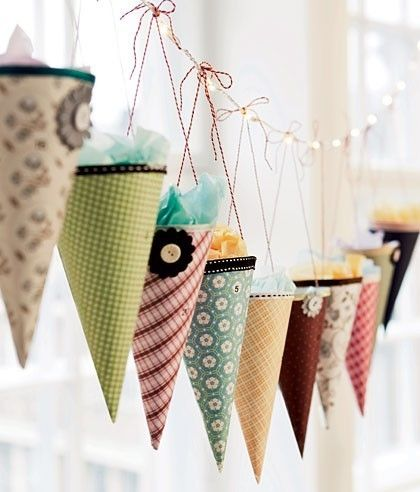 A cute idea for birthdays - party hats filled with candy, on a guirlande.