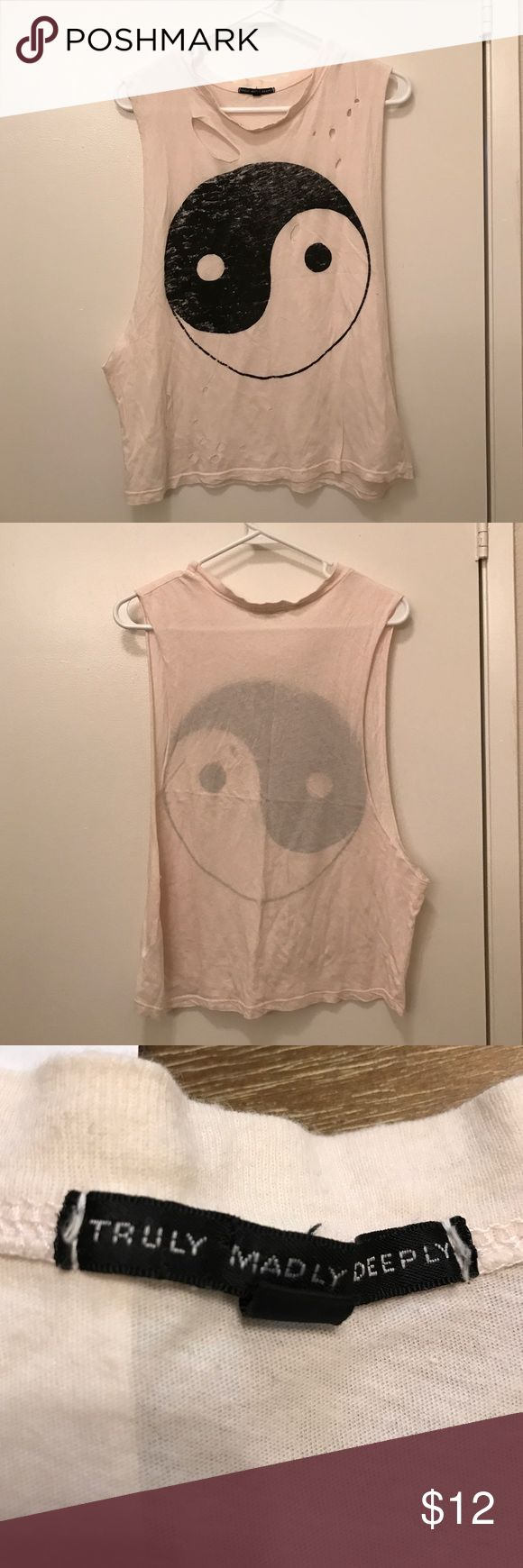 Muscle Tank Top Muscle tank top with a ying yang. Has holes on it (came like this). White and black colored. Size small. Urban Outfitters Tops Muscle Tees