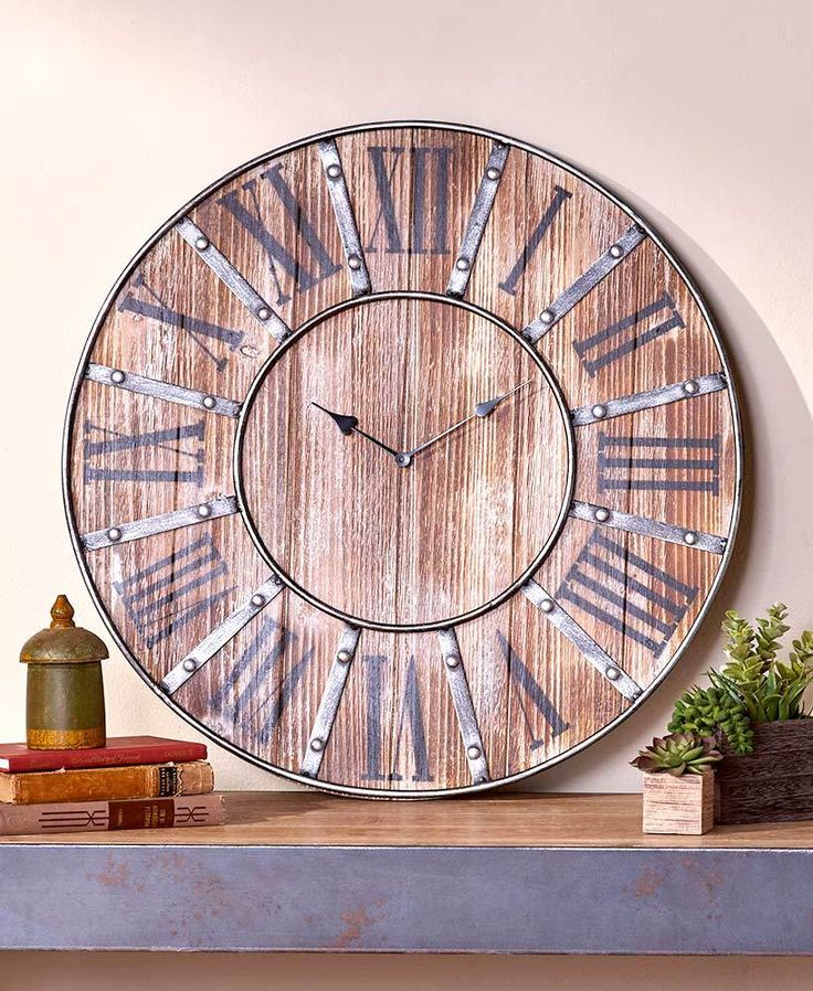 ThisRustic Farmhouse Clockis the perfect match for your family's laid back lifestyle. It has a wooden construction with an intentionally distressed finish an
