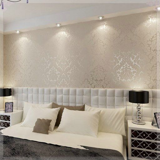 Master Bedroom ideas - extended mounted headboard, metallic damask wall paper, bedside tables and lamps