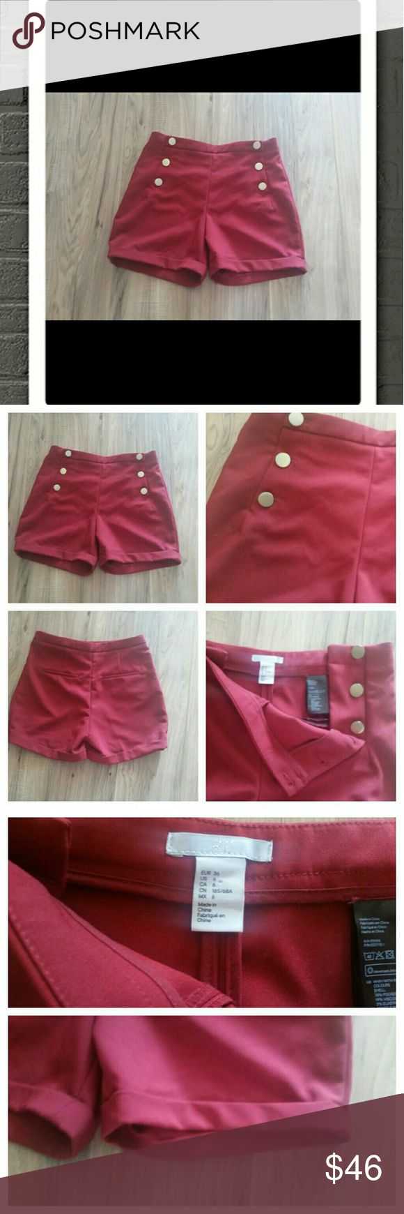 H&M red shorts size 6 Red delicious apple red H&M bandleader shorts size 6.  These shorts remind me of Gwen Stefani. Great condition. Short 78% polyester 19% viscose 3% elastane. Machine washable. H&M Shorts