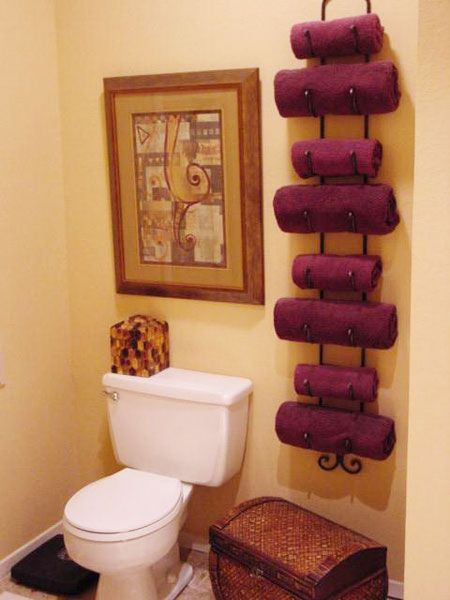 Use a wine rack as a towel rack to maximize space in small bathroom!