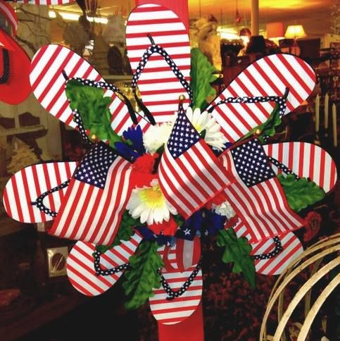 #Patriotic flip flop wreath with mini flags. #flipflops The perfect patriotic wreath for flip floppers! Original source unknown. More flip flop decor ideas on Completely Coastal: http://www.completely-coastal.com/2013/05/flip-flop-crafts-decorations-home.html