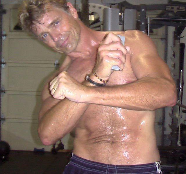Actor John Schneider shirtless body...