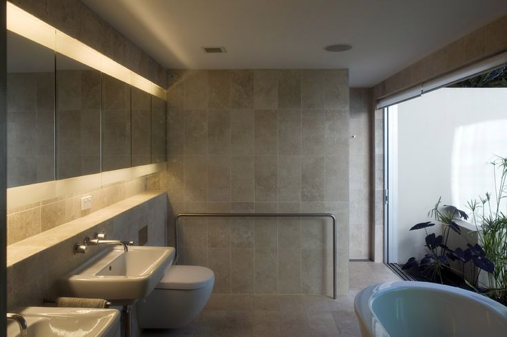 Fig Tree Pocket 2: Bathroom with framed view out to private courtyard space. See more at http://blighgraham.com.au/projects/fig-tree-pocket-house-2