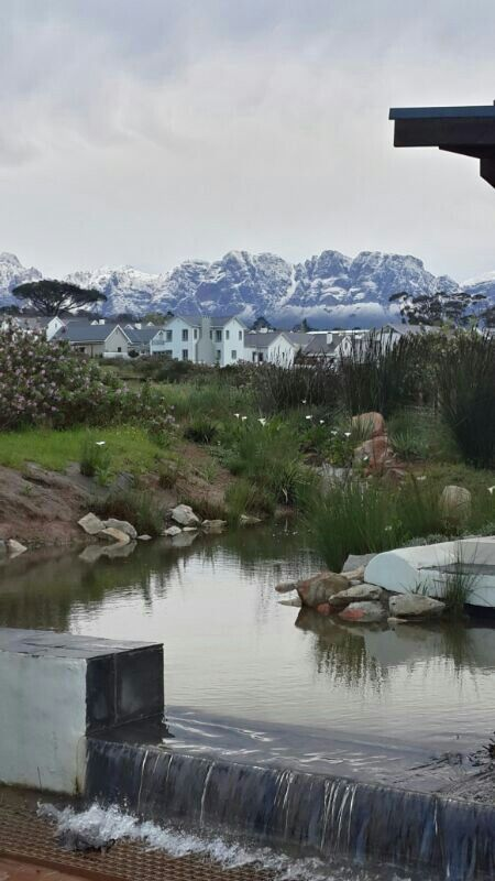 Winter in Somerset West, Helderberg, Cape Town - the snow capped Hottentots-Holland mountain range enfolds the town and wine estates in the area.