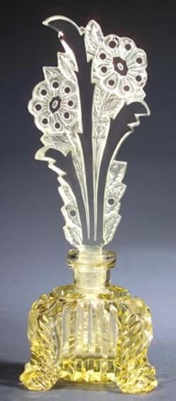 A perfume bottle, circa 1920s, in yellow crystal, with dauber. Stenciled oval MADE IN CZECHOSLOVAKIA...