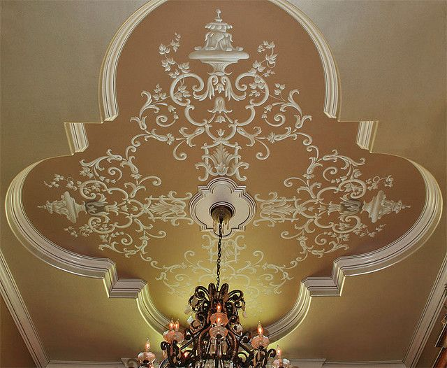 Scrollwork painted on dining room ceiling.