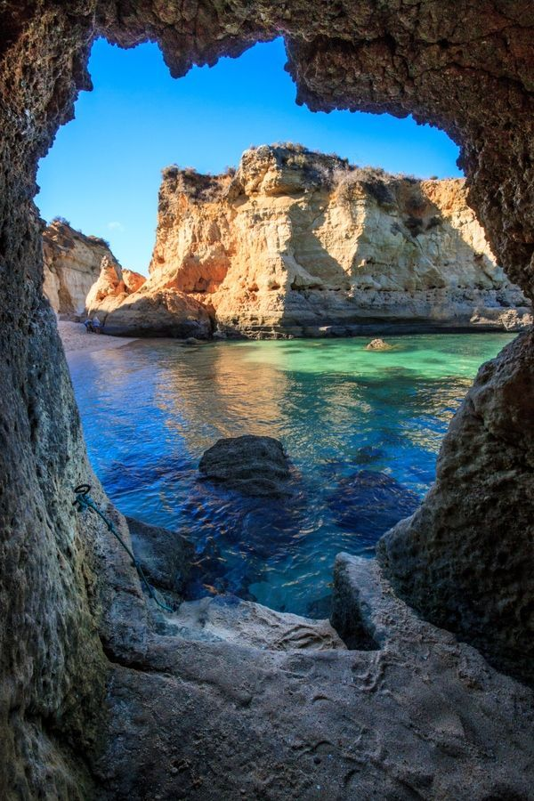 Portugal - Caves in Lagos.  Facts about Portugal: Area: 92,389 sq km occupying 15% of the Iberian Peninsula, which is shared with Spain. Also, the Atlantic islands of the Azores (2,247 sq km, nine islands) and Madeira (794 sq km, two islands).Population: 10,732,357. Capital: Lisbon. Official language: Portuguese. 9 languages.
