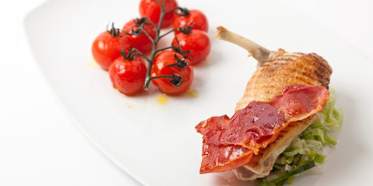 Grilled Guinea Fowl breast is used to create a tasty main in this recipe. Adam Gray complements the fowl with tomatoes and ham.