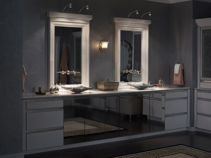 Lighting around the vanity increases visibility and adds a dramatic statement to your bathroom design.