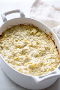 Quick and Easy Artichoke Dip ~ Quick easy hot artichoke dip with artichoke hearts, Parmesan, mayo, salt, pepper ~ SimplyRecipes.com