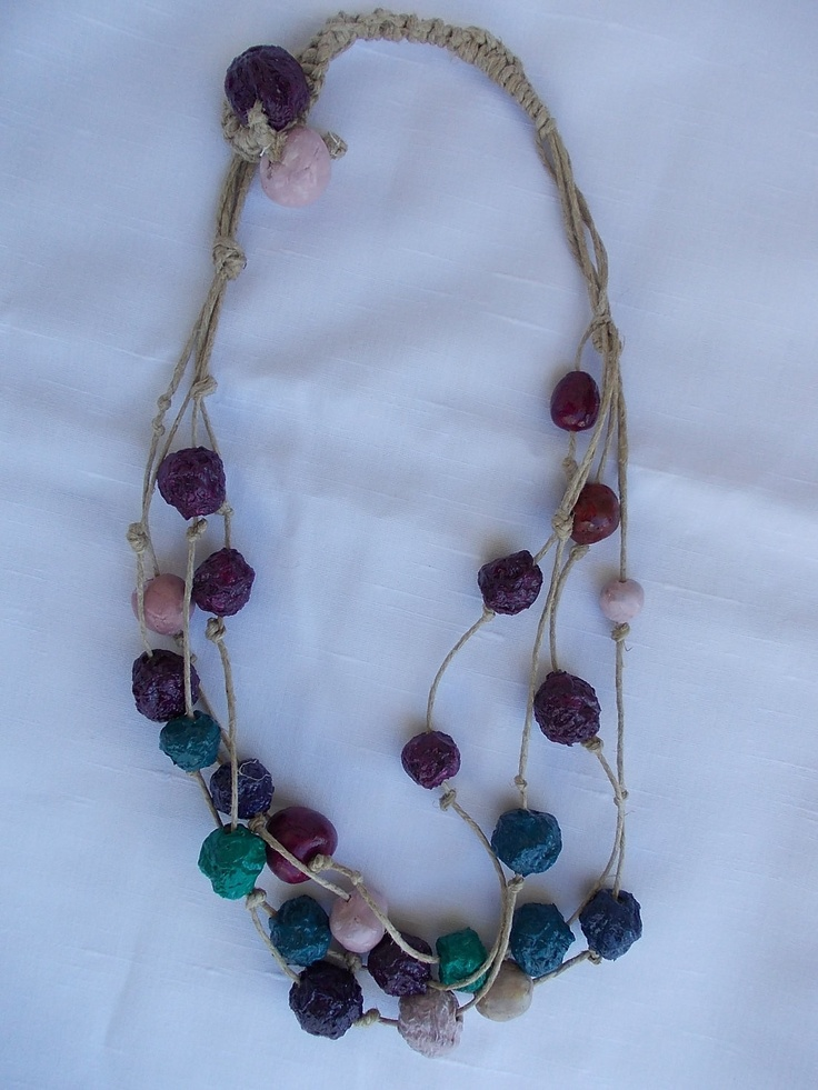 Necklace of colored terracotta and paper pulp beads.via Etsy.