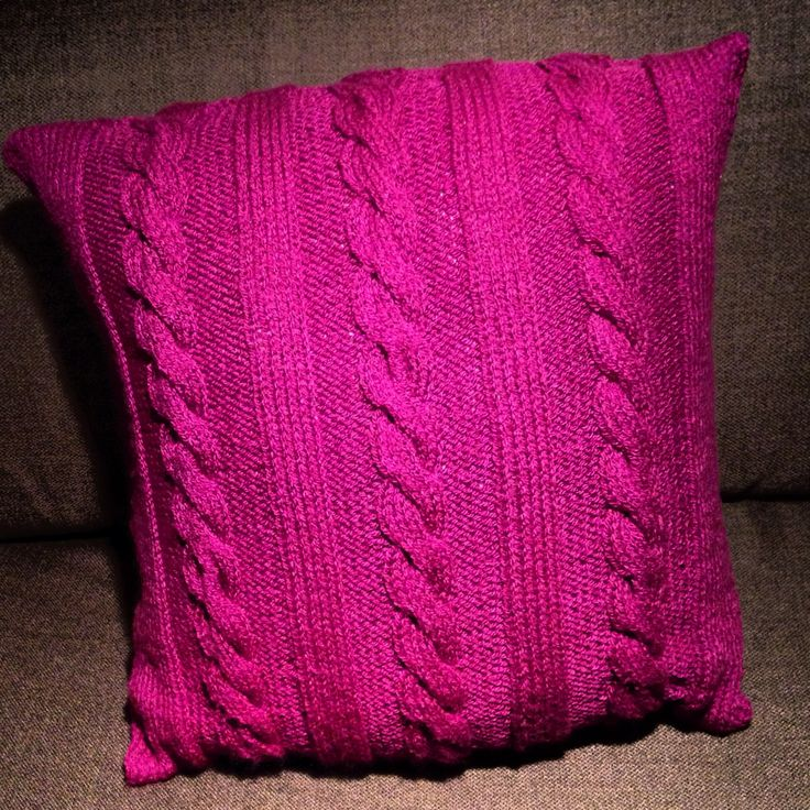 10 stitch cable twist knitted cushion. This cushion is hand knitted from a DK yarn and measures 40cm x 40cm