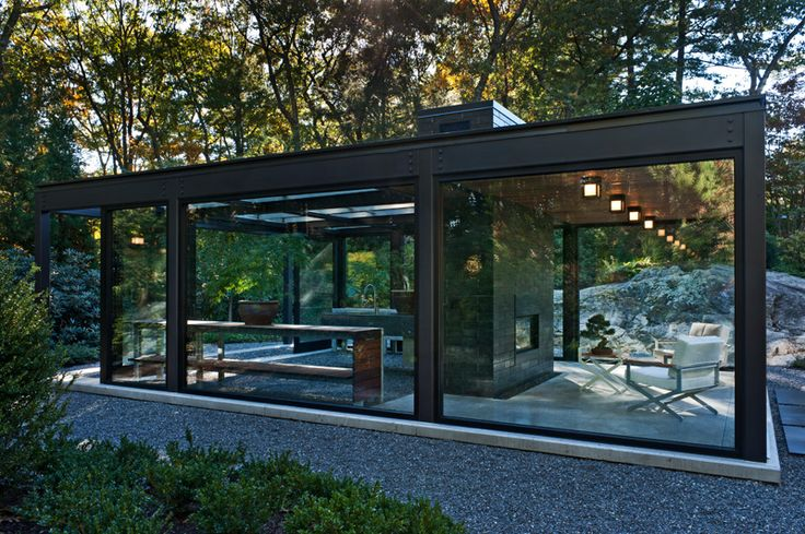 Glass House In The Garden By Flavin Architects And Zen Associates  A large chimney clad in glazed concrete block divides the building into two distinct volumes and evokes a mid century vibe. Project Architect Howard Raley refined the building to its essence of structural steel, aluminum window system and glass