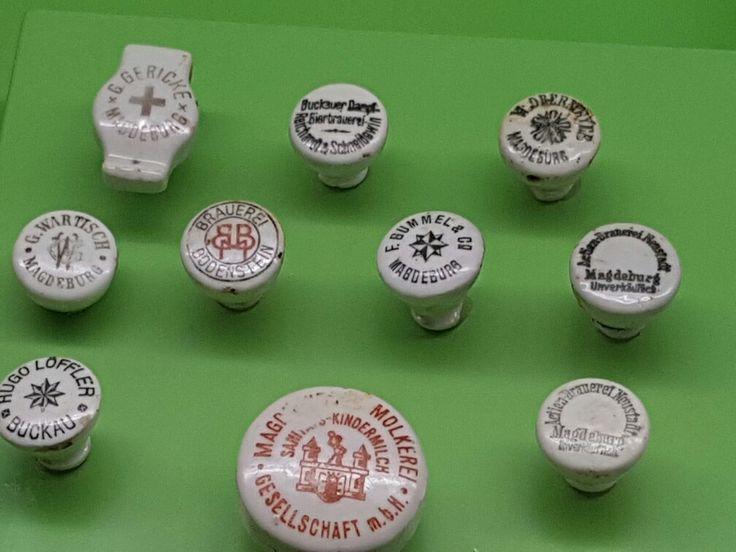 Alte Flaschenverschlüsse aus Porzellan.  Es fehlen nur die Metallbügel und die Gummidichtungen.