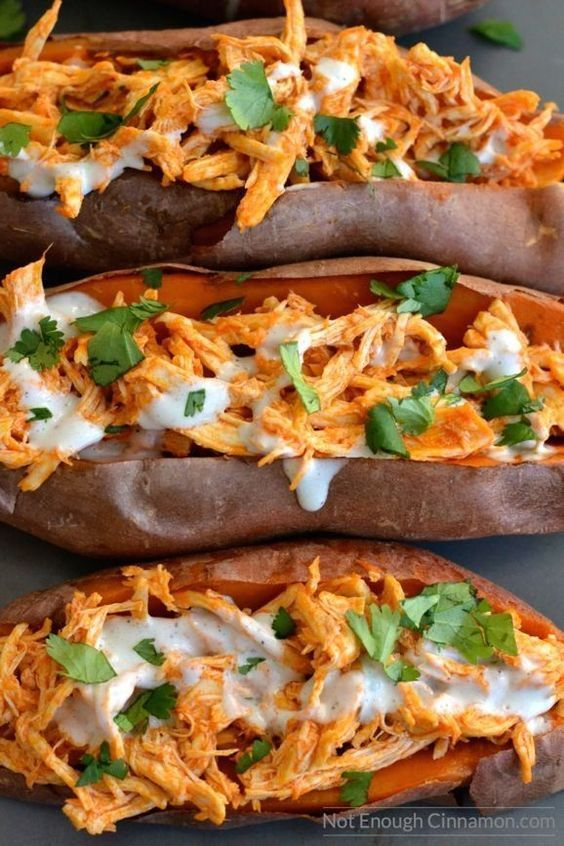 Baked sweet potatoes loaded with buffalo sauce shredded chicken   skinny blue cheese sauce! So delicious and comforting!