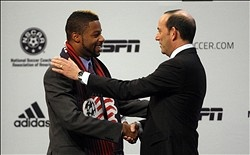 Andrew Ferrell (Louisville) shakes hands with MLS commissioner Don Garber after being selected as the number one overall pick to the New England Revolution in the 2013 MLS Superdraft at the Indiana Convention Center.  (Jerry Lai-USA TODAY Sports)