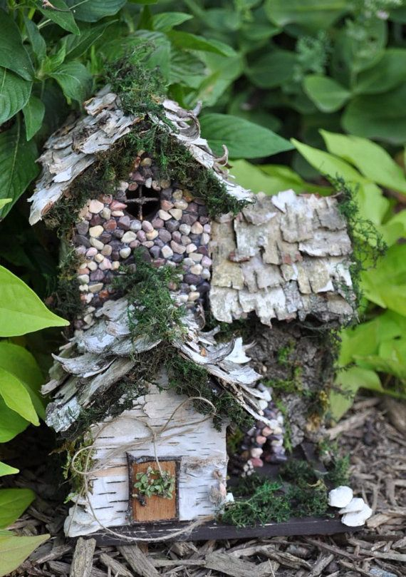 This little fall cottage comes complete with outdoor fireplace for warm cozy nights! A birch bark roof, lots of moss and stone details makes it a
