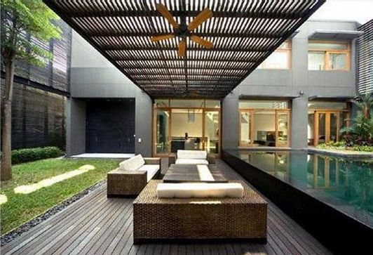 This style is me! The lines of furniture and building mesh so well with lines of furniture. Great modern courtyard...