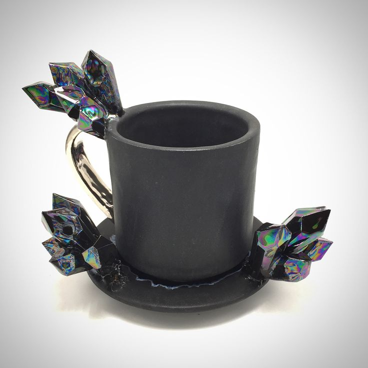 It's probably not advisable to grab hold of one of Collin Lynch's blinged-out crystal cups before you're fully awake. Working under the name Essarai Ceramics, Lynch specializes in oversized coffee mugs, each one a delightful riot of color and texture, with iridescent prismatic crystals seeming to ex
