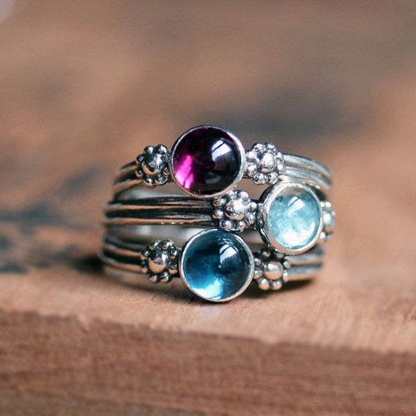 silver daisy flower triple ring set: in purple and two shades of blue.