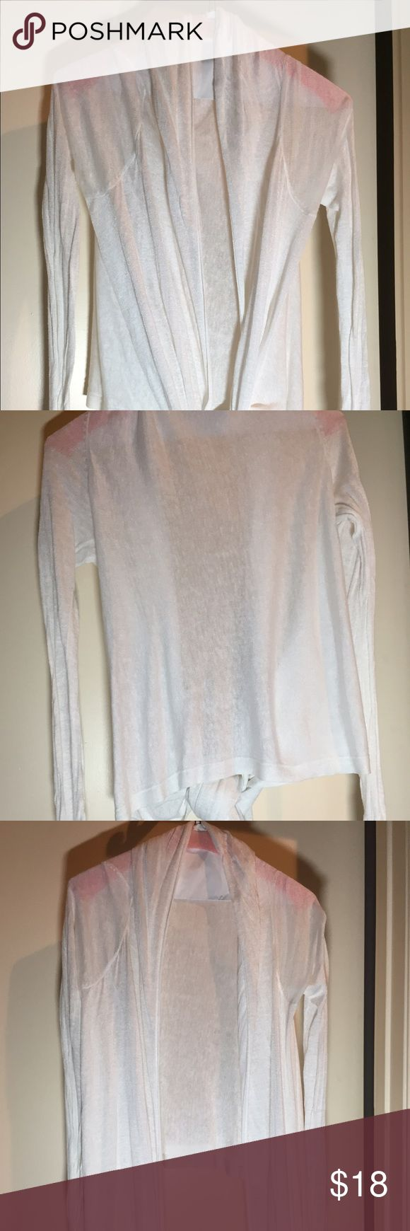 Victoria Secrets / Moda Inc. Sweater with tie Victoria Secret / Moda International Sweater Jacket which ties in front. Sheer solid white made from 63% Linen and 37% Rayon.  This sweater jacket looks great with a pencil skirt as did Natalie Morales of the Today show.   Hand wash in cold water Moda International Tops Camisoles