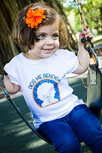 "Such a cute ""lanuguita"" proudly showing off her Hispanic heritage in a cute t-shirt. Dios la bendiga!"