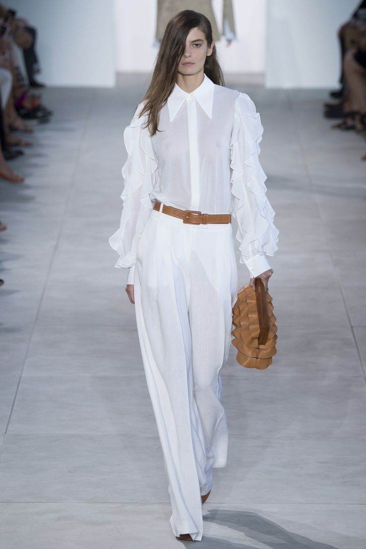 Spring Studios has been the home of the Michael Kors' runway show for several seasons now and it was always laid out in your traditional up and back format. Walking into the Tribeca space this year...