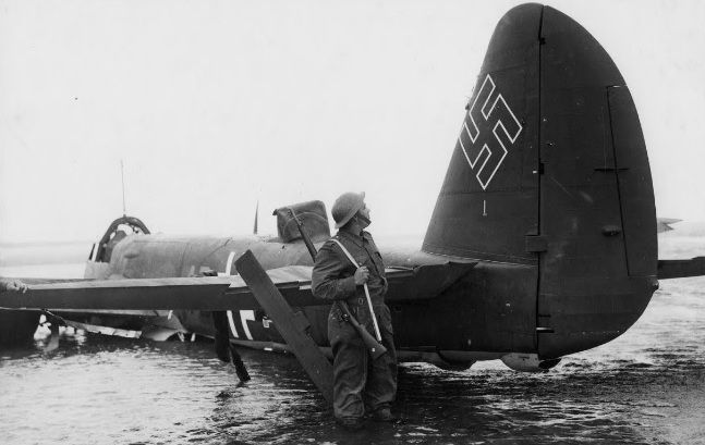 """Sortied to attack London docklands on 9 September 1940, Ju88A-1 4D+AD of Stab 3/KG30 was claimed by S/L Alexander VR """"Sandy"""" Johnstone, P/O Archibald """"Pat"""" Lyall and and by F/O Paul C Webb of No 602 Squadron RAF 20m north of Mayfield at 17.40 before being forced down on the waterfront at Pagham Harbour. Photographer Frank Lalouette from Bognor Regis shows a single white stripe underneath the swastika with the date 2.9.40 denoting an RAF fighter the crew had claimed on the day."""