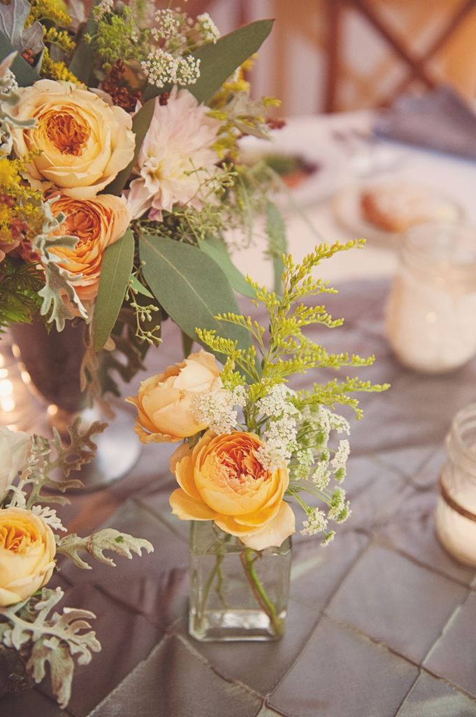 August centerpieces in yellow and peach designed by Love 'n Fresh Flowers.  Photo by Maria Mack Photography.