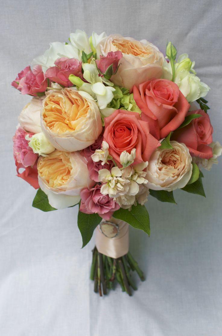 gorgeous peach juliet roses, coral roses, peach stock, spray roses, white freesia bridal bouquet