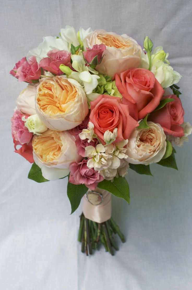 gorgeous peach juliet roses, coral roses, peach stock, spray roses, white freesia bridal bouquet