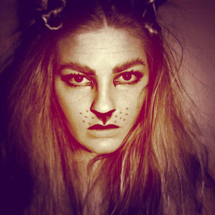 Lion Halloween makeup.