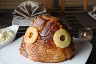 A spiral ham is a simple centerpiece for a meal that will feed a crowd. Cooking takes only a few steps, and because the ham is already sliced it can easily be carved and served at meal time. The key to a juicy ham is to be sure not to overcook it.