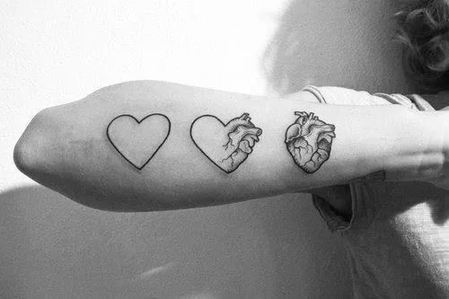 cartoon to realistic heart tattoo