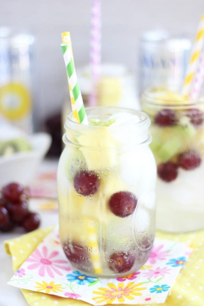 Enjoy a Tropical Sparkling Water as the weather gets warmer. This refreshing recipe includes kiwi, pineapple, and grapes. This beverage will be great as summer approaches.