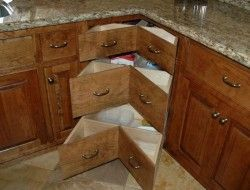 Corner cupboards in kitchens tend not to work very well. 'Lazy Susan's' help but it's still not easy to store and find. The owners of this kitchen decided to remove their lazy susan with specially designed drawers that can make the space more functional. A corner cupboard without even a lazy Susan setup is very awkward to use. Yes, you can access all the space, but only with considerable difficult. Enter the 'lazy Susan'... it's certainly easier to access items, bu...