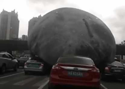 A giant inflatable moon rolled uncontrollably through China today. - 9GAG