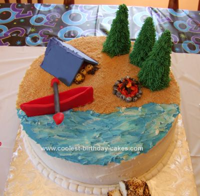 Homemade Camping Cake: This is a Camping Cake that I made for my husband's 30th birthday. The canoe, tent, campfire rocks and campfire logs are were all made out of fondant ahead