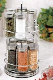 Item Number: VP765  Price: $59.98     Beauty and function collide with this stunning glass and stainless steel spice rack!     Sleek, smooth-spinning stainless steel stand makes a beautiful addition to your countertop, while keeping your favourite spices within easy reach.     Includes 12 - 2.5oz. glass spice jars with stainless steel lids and snap-on shaker caps.