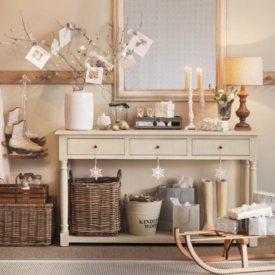 Cards and gifts are beautifully displayed alongside a large mirror and classic cream console table in this hallway.